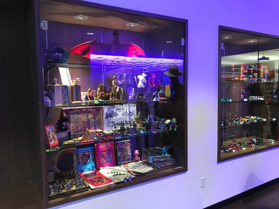 A collection of fantasy games and toys on display at the Abilene Public Library's mall branch in preparation for Lib-Con.