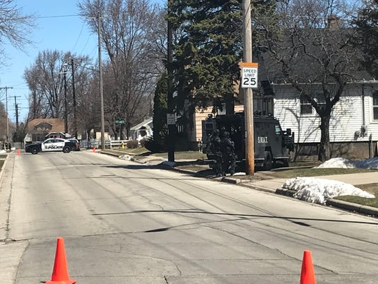 Green Bay Police officers closed off streets around