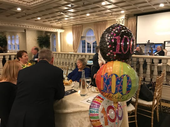 Nutley's Ruth Bedford greets guests at her 100th birthday