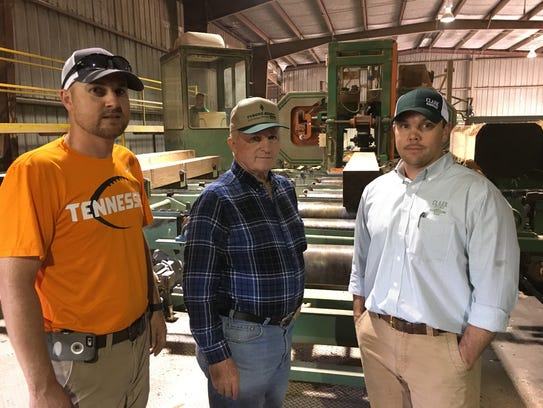 Phil Averitt, center, recently sold his Houston County sawmill to Brandon Clark, right, owner of Clark Hardwoods, who will have Heath Honeycutt, left, manager the operation.