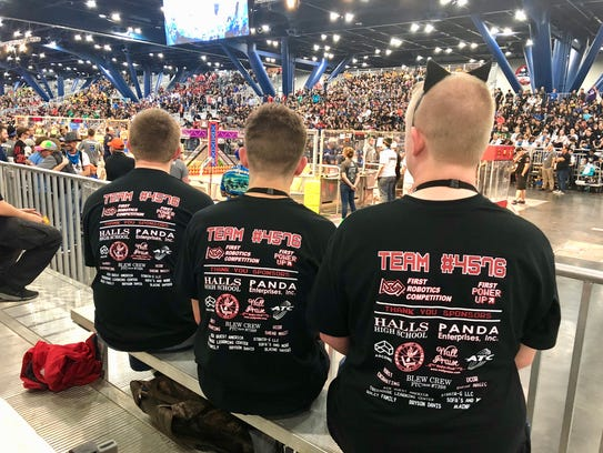Members of the Red Nation Robotics Team #4576 watch