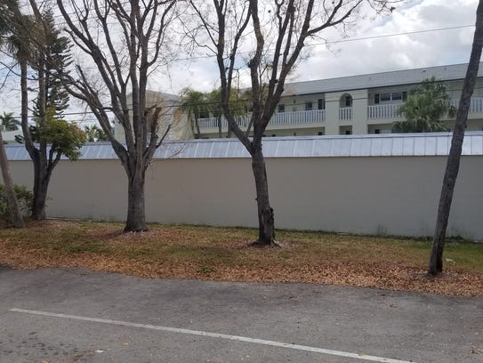 Wall of condo complex garage is on the boundary line