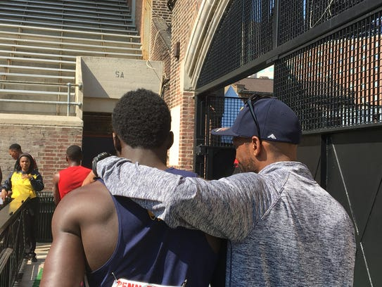 Mario Heslop gets some advice from FranklIn track coach