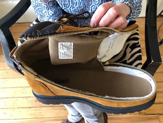 A pair of adult boots Jill Glidden, of Sweden, modified