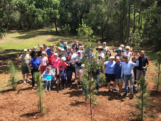 Stuart Sunrise Rotary Club members at the end of a
