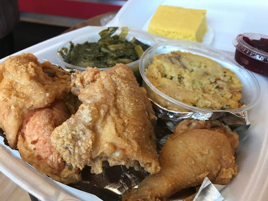 Great side dishes for Nino's fried chicken include collard greens and cornbread dressing.