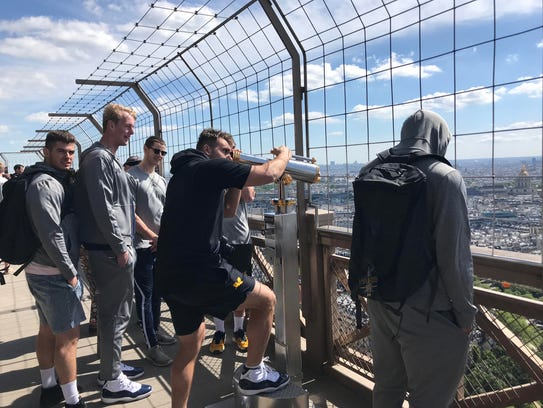Michigan football players check out the view from the