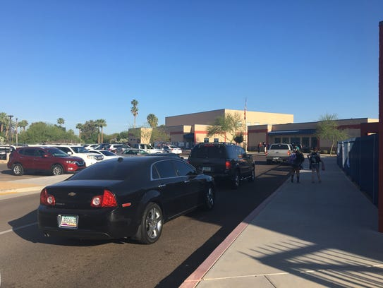 A line of cars waits to drop off students at Ingleside