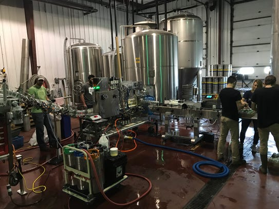 The Iron Heart mobile canning line in action at Canandaigua's