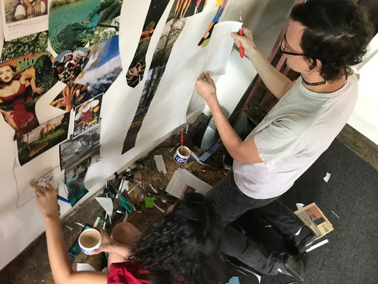 Students work on Waging Peace exhibit opening Friday