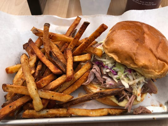 The pulled pork shoulder sandwich comes topped with