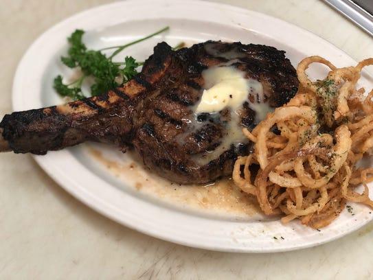 Steaks like the bone-in ribeye at the Butler Inn of