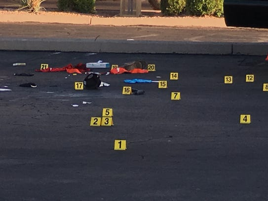 Investigators marked evidence in a Mesa parking lot