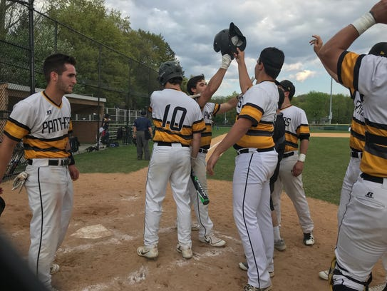 Cedar Grove baseball salutes Ryan Turi (center) after