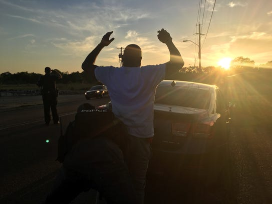 An officer frisks a man after he is stopped on a violation.