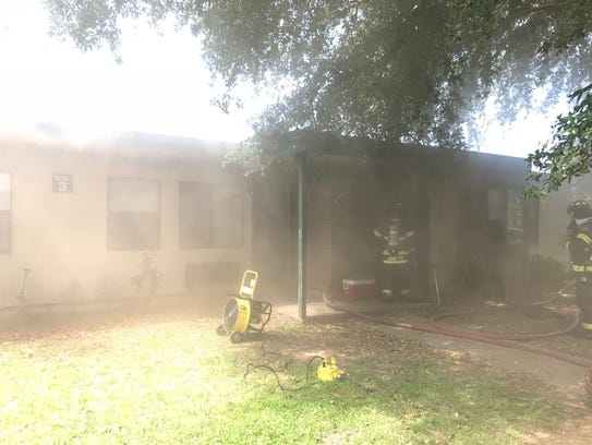 An apartment was damaged by a fire at 2300 Riverwood