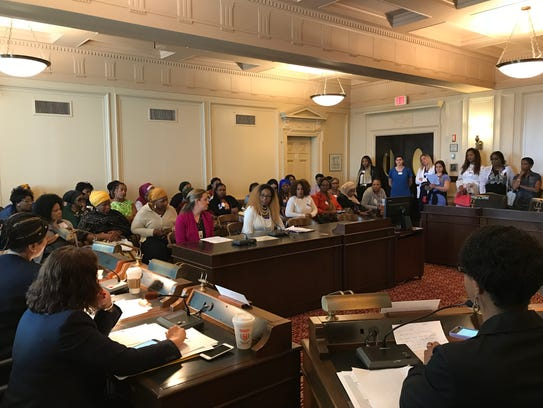 Brigitte Nzila, of Gloucester Township, urges lawmakers