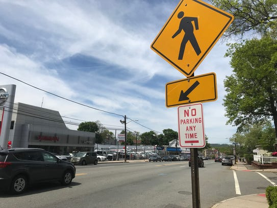 A car rides along Bloomfield Avenue on Friday, May