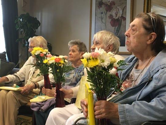 Wlomen at Brandywine Senior Living in Howell hold the