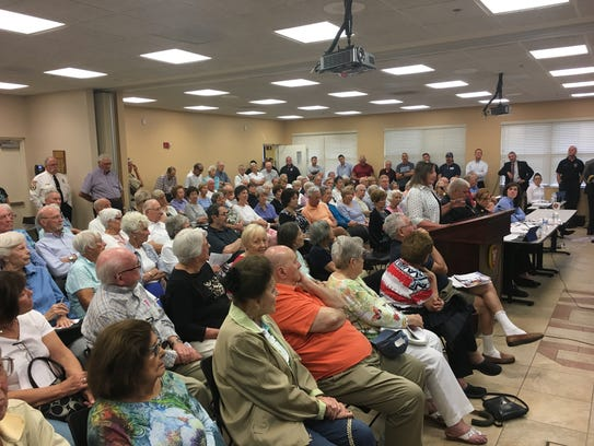 Residents of the North Collier Fire District listen