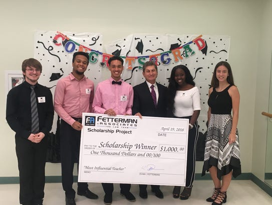 Attorney Evan Fetterman, center, with the five students