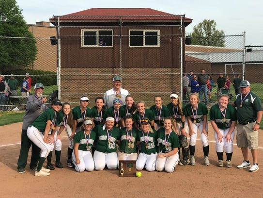 The Madison Lady Rams pose for a team photo after winning