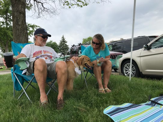 Rick (left) and Kris Granahan, with dog Tequila, tailgate