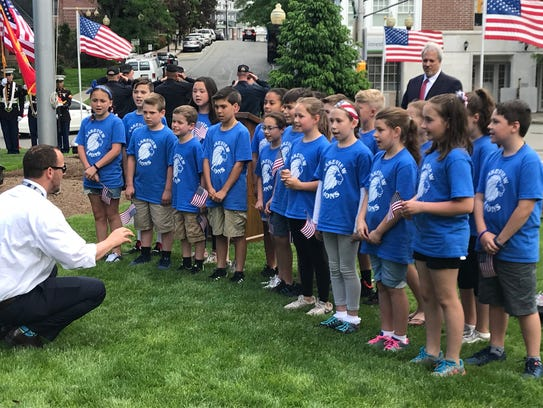 Students from Lakelview Elementary School sing the National Anthem Wednesday during the annual Morris County Memorial Day Commemoration honoring military veterans on the lawn of the Morris County Courthouse. May 23, 2018.