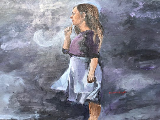 """Anna Wright, 17, of Breaux Bridge is creating a collection of art pieces representing American Sign Language and those who rely on it for communication. She created this piece, """"Loneliness,"""" with acrylic paint on wood during Festival International."""
