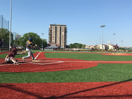 Lyndhurst batter Matt Tomko makes contact with a pitch