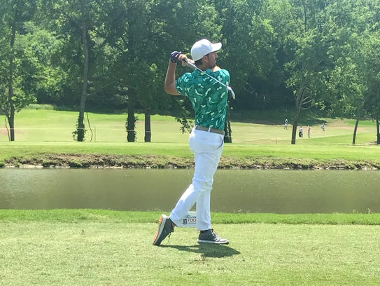 Country music artist Jake Owen works on his swing at