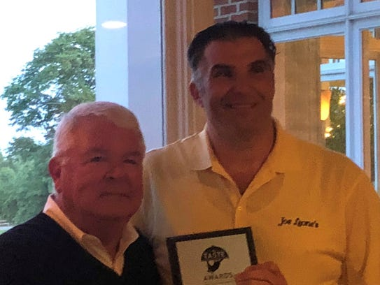 Joe Leone (right) accepted his award from Jim Flynn, chairman of ShoreFoodie.com.