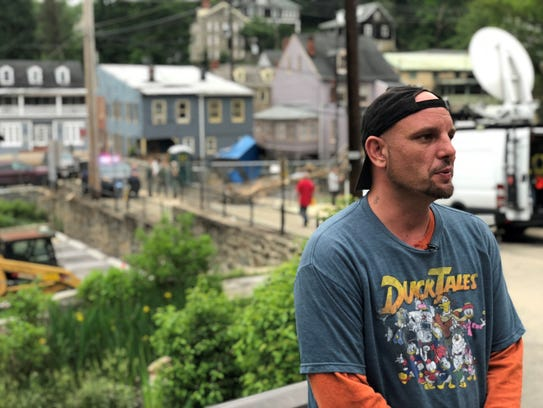 Toy shop owner Jason Barnes doesn't know whether he will rebuild again after a second flood in two years in Ellicott City, Md.