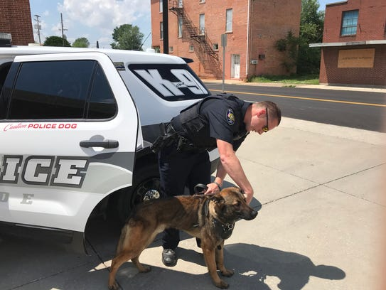 Clyde Police officer Tony Travagliante takes K-9 Chase