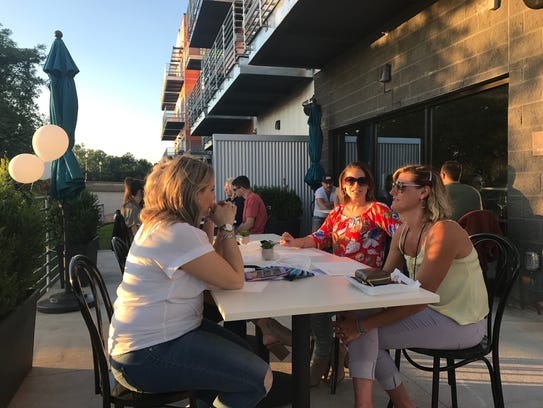 Patrons on the patio at MP Social, June 1, 2018.