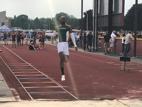 Greece Olympia senior Joshua McCleary competes in the long jump during the 2018 Section V state qualifier.