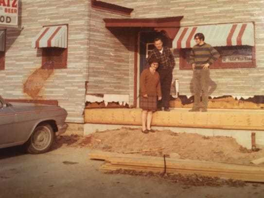 Dick Wertel, right, stands with his mother and father,