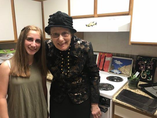 Ilana Feder, 14, and Rosalie Kallner, 86 pose in Kallner's