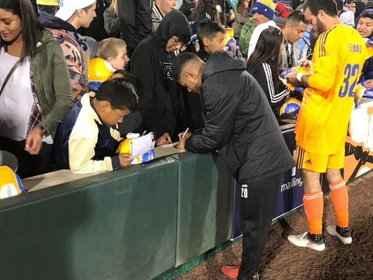 Kevin Partida signs autographs after a game last month