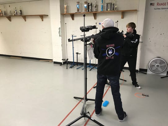 Kevin Behan and Bryn Preston prepare to shoot at the