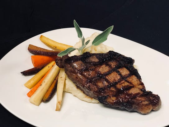 The bison ribeye from Range Grill + Golf.