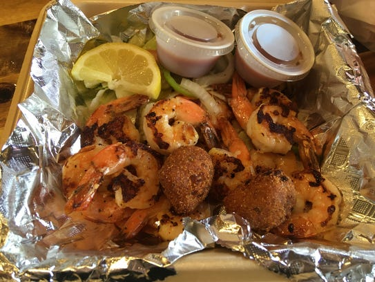 The 12-piece grilled shrimp meal ($13.99) was the highlight