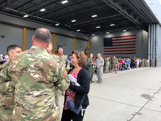 Guardsmen chat with Paula Lee of Colchester, offering