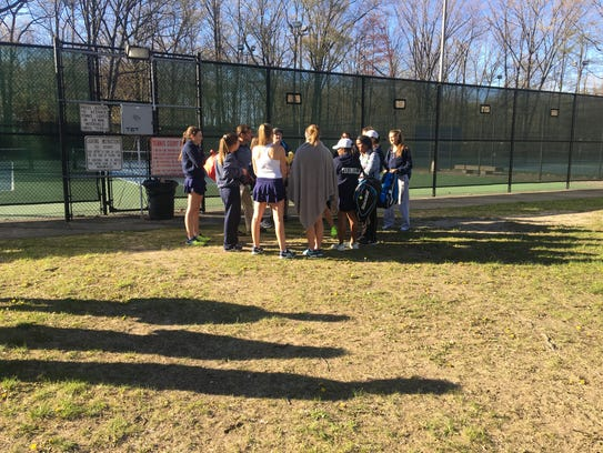 The Port Huron Northern tennis team talks after Monday's