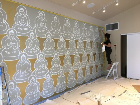 Yoga celebrity paints 10 000 buddhas mural in la quinta for Celebrity mural