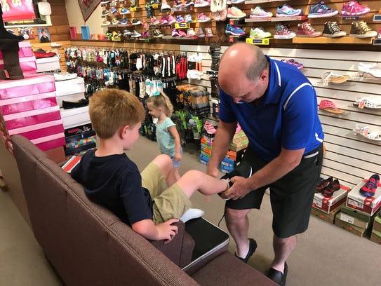 Ken Wrisley, owner of Giblings Footwear in Oakland,