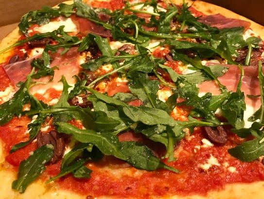 The Paradise pizza with prosciutto, kalamata olives