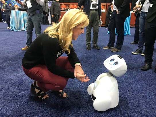 Buddy the companion robot, with columnist Jennifer