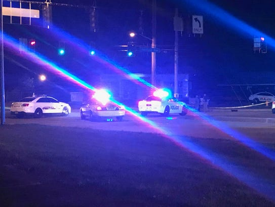 Evansville police cars block Diamond Avenue at intersection