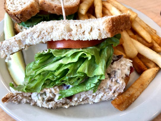 A chicken salad sandwich served on seven-grain bread